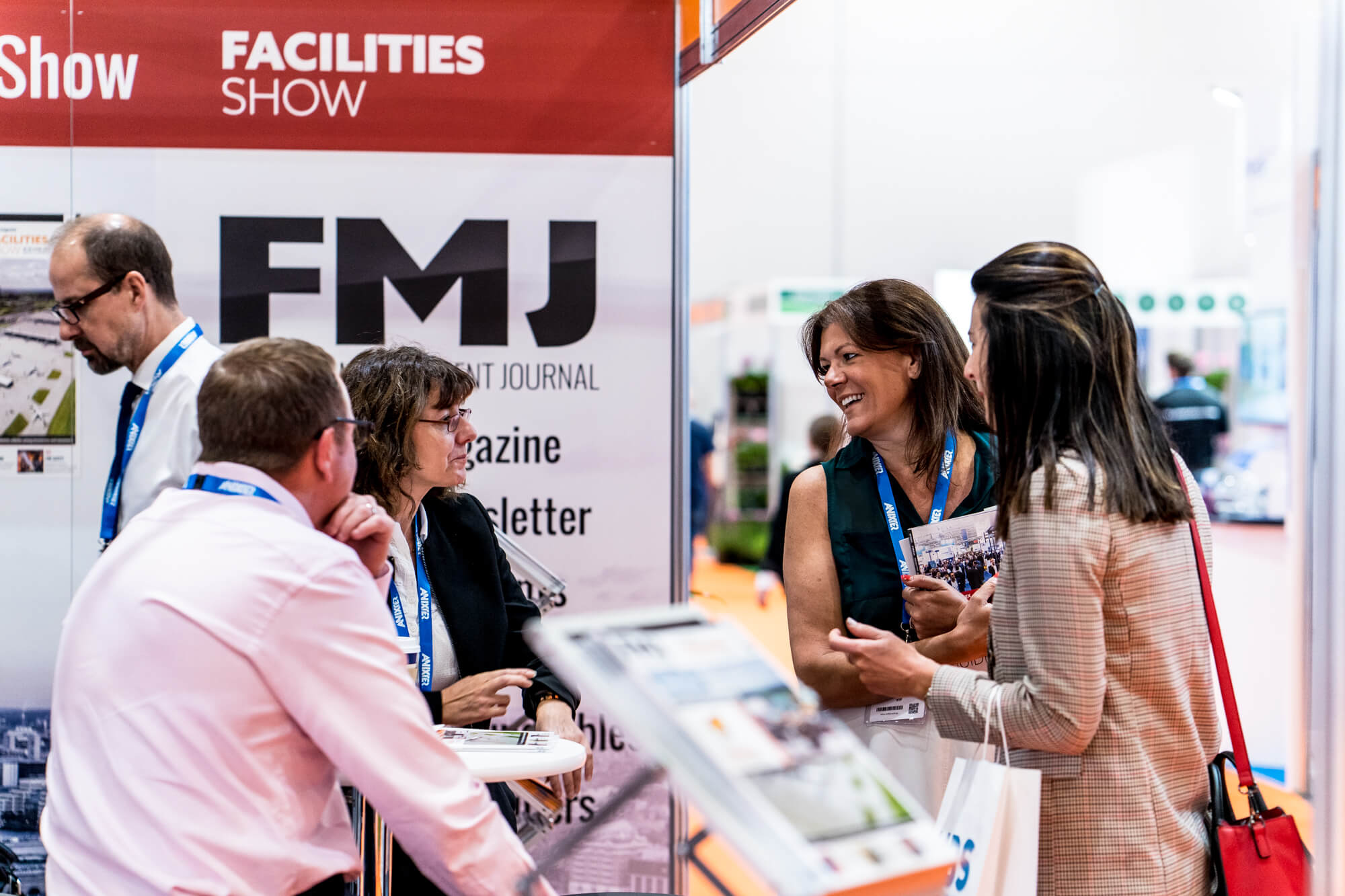 An exhibitor and visitor having a conversation at Facilities Show 2019
