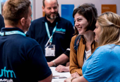 Four people talking at Facilities Show 2019