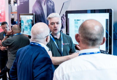 2 people listening to an exhibitor explaining at Facilities Show 2019
